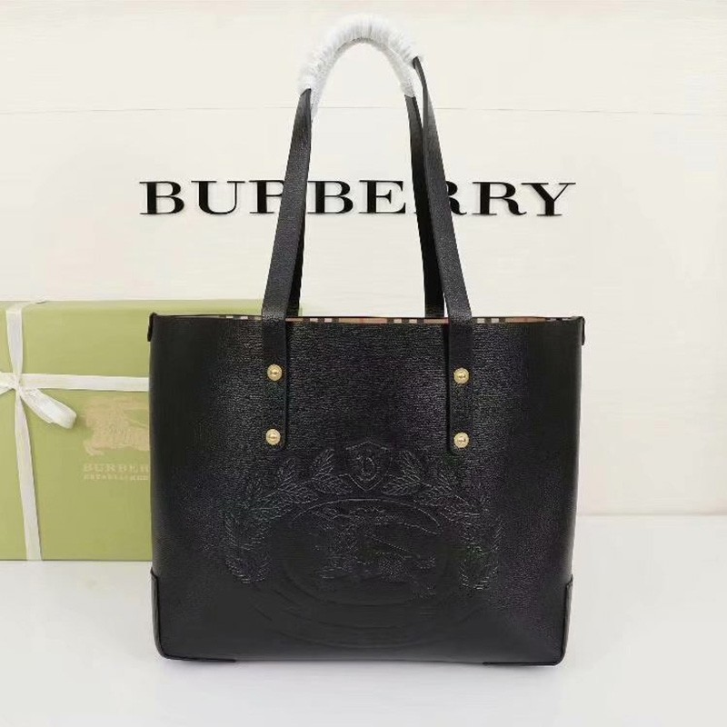Burberry Embossed Crest Leather Tote In Black